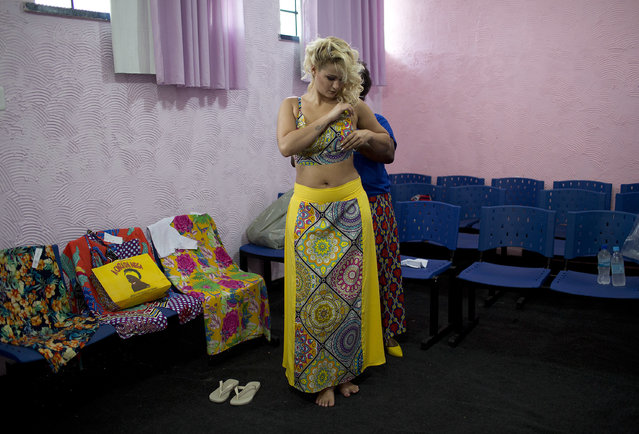 Inmate Mariana Santos da Silva, 23, who is serving time prepares to compete at the annual beauty contest at Talavera Bruce penitentiary in Rio de Janeiro, Brazil, Tuesday, December 4, 2018. The clothes the contestants compete in are on loan from a local business. (Photo by Silvia Izquierdo/AP Photo)