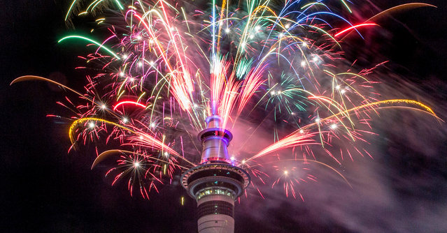 Fireworks explode from Auckland's Sky Tower as the new year is welcomed to New Zealand, January 1, 2017. (Photo by Peter Meecham/New Zealand Herald via AP Photo)