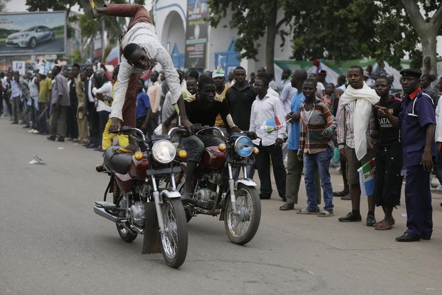 Supporters of President Elect, Gen. Muhammadu Buhari, celebrate his victory in Abuja, Nigeria, Wednesday, April 1, 2015. Nigerian President Goodluck Jonathan conceded defeat to Buhari, a 72-year-old former military dictator, who was elected in a historic transfer of power following the nation's most hotly contested election ever. (Photo by Sunday Alamba/AP Photo)