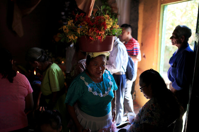 "Catholic faithful prepare to participate on a procession during the ""Fiesta de las Palancas"" celebration to ask for blessings and abundance during the new year in Panchimalco, El Salvador, January 5, 2017. (Photo by Jose Cabezas/Reuters)"