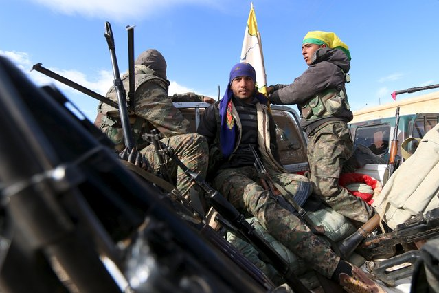 Syria Democratic Forces fighters ride a vehicle with their weapons in a village on the outskirts of al-Shadadi town, Hasaka countryside, Syria February 19, 2016. (Photo by Rodi Said/Reuters)