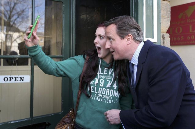 Britain's Prime Minister David Cameron poses for a selfie with a local woman as he campaigns in Alnwick,  April 13, 2015. (Photo by Peter Macdiarmird/Reuters)