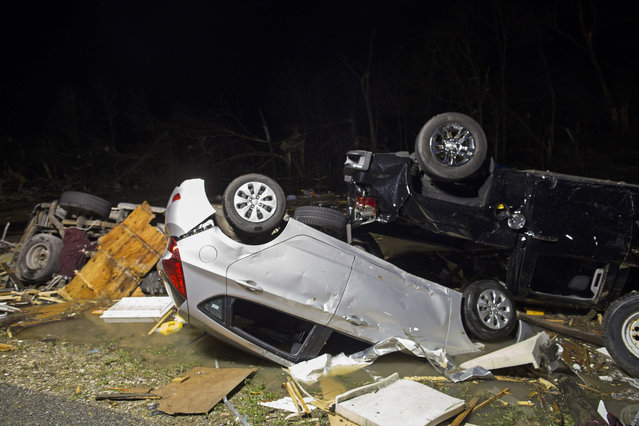 Destroyed trailers and vehicles are all that remain of the Sugar Hill RV Park after a suspected tornado hit in Convent, La., Tuesday, February 23, 2016. Tornadoes and severe weather ripped through southern Louisiana and Mississippi on Tuesday. (Photo by Max Becherer/AP Photo)