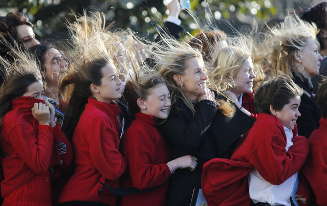 Sixth grade students from the Park Maitland School in Maitland, Florida, watch as Marine One carrying U.S. President Barack Obama takes off from the South Lawn at the White House in Washington as he departs for Las Vegas, January 29, 2013. (Photo by Larry Downing/Reuters)