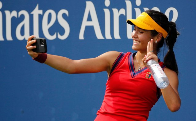 Emma Raducanu of Great Britain takes a selfie after victory over Stephanie Voegele of Switzerland in the first round of the women's singles of the US Open at the USTA Billie Jean King National Tennis Center on August 31, 2021 in New York City. (Photo by Rex Features/Shutterstock)