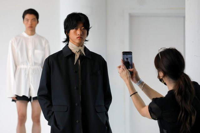 A person captures a model on a cellular device as he poses while presenting creations from the ONYRMRK Spring/Summer 2022 collection at New York Men's Day during New York Fashion Week in Manhattan, New York City, U.S., September 8, 2021. (Photo by Andrew Kelly/Reuters)