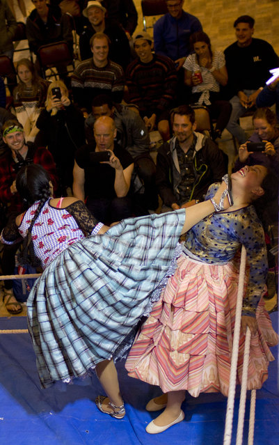 Young cholita wrestlers Wara, left, and Natalia Pepita compete in the ring in El Alto, Bolivia, Thursday, February 7, 2019. About 50 young women like Pepita and Wara are training at schools to take up the sport, some at an institution known as Independent Wrestlers of Enormous Risk. (Photo by Juan Karita/AP Photo)