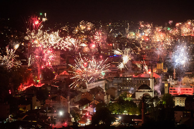 Fireworks light the night sky during FC Zeljeznicar's celebration of its 100th birthday in Sarajevo, Bosnia and Herzegovina on September 19, 2021. (Photo by Elman Omic/Anadolu Agency via Getty Images)