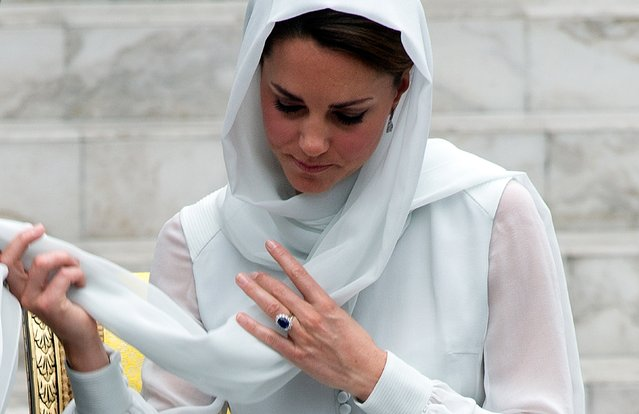 Britain's Prince William's wife Catherine, the Duchess of Cambridge adjusts her scarf outside a mosque at KLCC in Kuala Lumpur on September 14, 2012, on the second leg of a nine-day Southeast Asian and Pacific tour marking Queen Elizabeth II's Diamond Jubilee. (Photo by Saeed Khan/AFP Photo)
