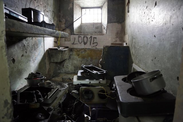 This April 9, 2015 photo shows a jail cell filled with cooking and electronic equipment left behind by prisoners being transferred from the Garcia Moreno Prison to a new facility, in Quito, Ecuador. Also left behind were rapidly scribbled phone numbers and written promises to never return to prison. (Photo by Dolores Ochoa/AP Photo)
