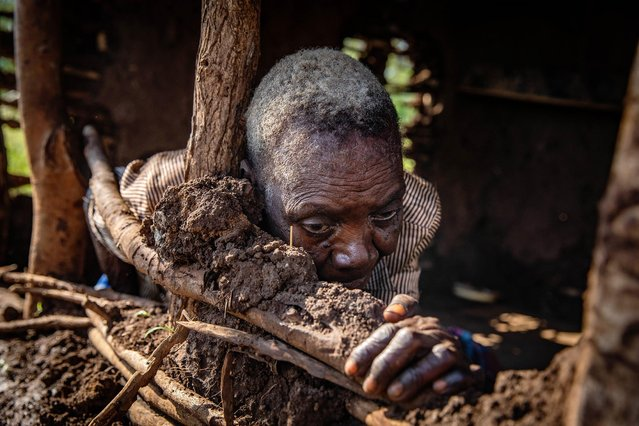 An elderly woman is found abandoned in a flood-damaged dwelling in a remote village on March 26, 2019 in Sofala Province, Mozambique. Tropical Cyclone Idai is considered one of the worst cyclones to affect Africa as it swept through Malawi, Zimbabwe and Mozambique leaving hundreds dead and an estimated three million people displaced. (Photo by Luke Dray/Getty Images)