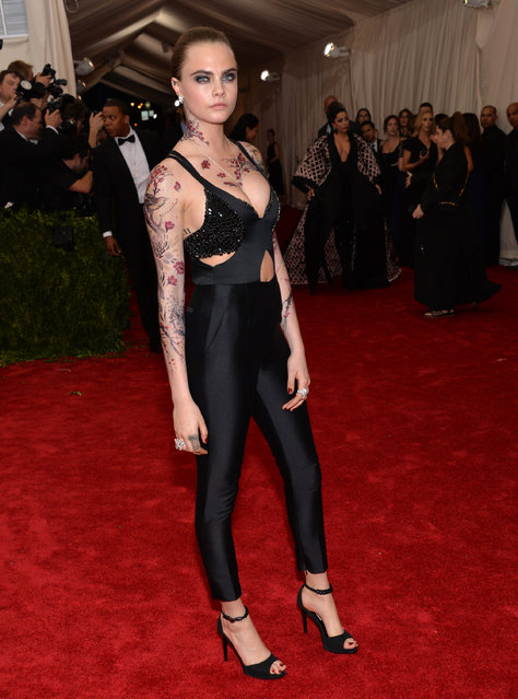 """Cara Delevingne arrives at The Metropolitan Museum of Art's Costume Institute benefit gala celebrating """"China: Through the Looking Glass"""" on Monday, May 4, 2015, in New York. (Photo by Evan Agostini/Invision/AP Photo)"""