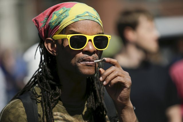 A man smokes a joint while people take part in a rally calling for marijuana to be legalized at Union Square in New York May 2, 2015. (Photo by Eduardo Munoz/Reuters)