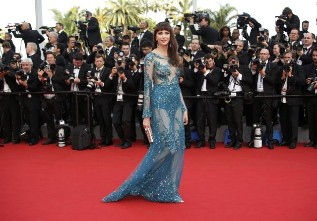 """Actress Frederique Bel poses on the red carpet as she arrives for the opening ceremony and the screening of the film """"La tete haute"""" out of competition during the 68th Cannes Film Festival in Cannes, southern France, May 13, 2015. (Photo by Eric Gaillard/Reuters)"""