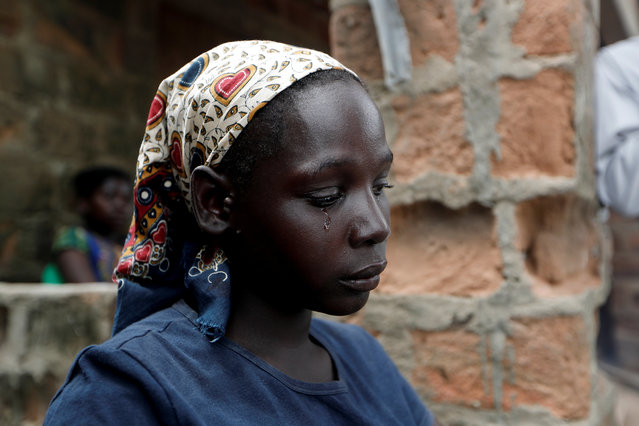 A tear falls down the face of Maria Jofresse, 25, during an interview with Reuters at a camp for the displaced in the aftermath of Cyclone Idai, in John Segredo, near Beira, Mozambique, March 31, 2019. (Photo by Zohra Bensemra/Reuters)