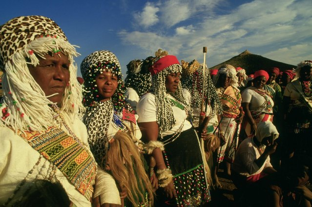 Pictured here is a group of Kwa-Zulu Sangomas wearing their traditional costumes in the Funze region, north of Durban. Location: Funze region, north of Durban, South Africa. (Photo by Patrick Durand/Sygma via Getty Images)