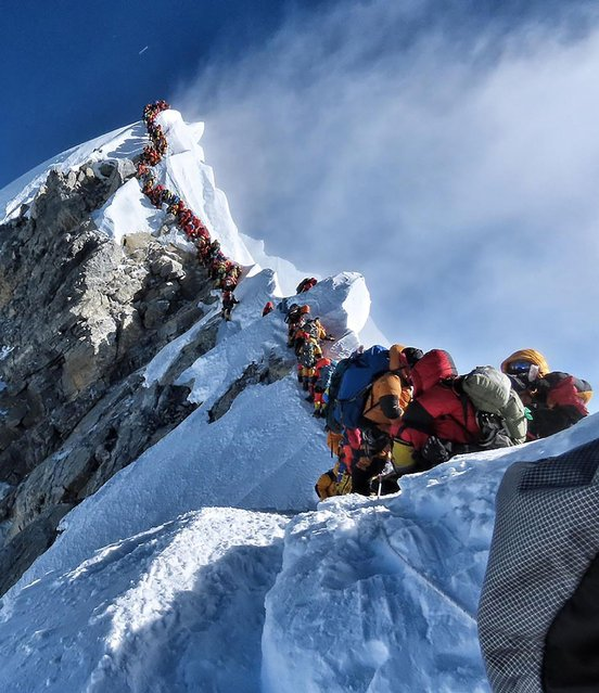 In this file handout photo taken on May 22, 2019 and released by climber Nirmal Purja's Project Possible expedition shows heavy traffic of mountain climbers lining up to stand at the summit of Mount Everest. Three more climbers have died on Everest, expedition organisers and officials said on May 24, taking the toll from a deadly week on the overcrowded world's highest peak to seven. (Photo by Handout/Project Possible/AFP Photo)