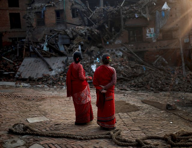 Women look at a collapsed building caused by earthquakes, in  Bhaktapur, Nepal, May 18, 2015. (Photo by Ahmad Masood/Reuters)