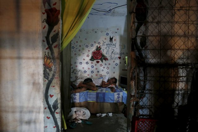 Inmate Alvis Javier sleeps in his cell inside the transgender gallery in La Joya prison on the outskirts of Panama City, Panama November 12, 2015. (Photo by Carlos Jasso/Reuters)