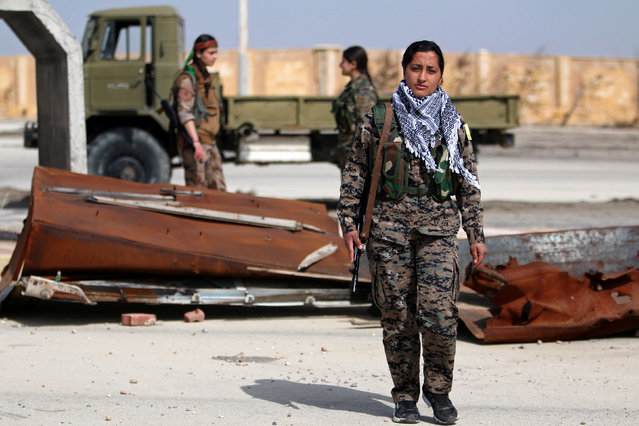 """Laila Sterk, 22, a Syrian Democratic Forces (SDF) female fighter, poses for a photograph in the northeastern Syrian city of Hasaka, Syria, February 26, 2017. """"Before becoming a fighter, I was suffering from inequality in society. But after joining the Syrian Democratic Forces (SDF), I didn't encounter that anymore"""", said Sterk. """"This is due to the fact that when men want to join the SDF they attend educational courses about women fighting alongside them. Therefore the woman fighter leads the military campaigns just like any man"""". (Photo by Rodi Said/Reuters)"""
