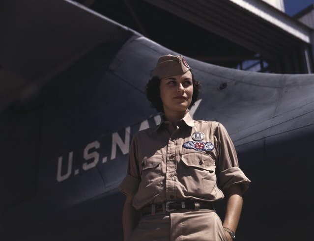 Portrait of Assembly and Repairs Department senior supervisor Eloise J. Ellis as she stands near the tail of a Navy plane at Naval Air Station, Corpus Christi, Texas, August 1942. (Photo by Howard R. Hollem/Getty Images)