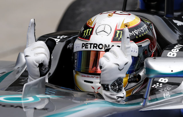 Mercedes driver Lewis Hamilton of Britain gestures in his car after winning the Malaysian Formula One Grand Prix at Sepang International Circuit in Sepang, Malaysia, Sunday, March 30, 2014. (Photo by Vincent Thian/AP Photo)