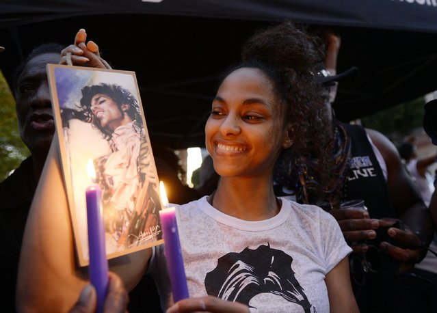 Julya Baer, 30, attends  a candlelight vigil and celebration of Prince's life in Leimert Park in memory of musician Prince on April 21, 2016, in Los Angeles, California. Prince died earlier today at his Paisley Park compound at the age of 57. (Photo by Kevork Djansezian/Getty Images)
