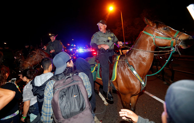 Sheriffs on horseback and police break-up a group of demonstrators outside Republican U.S. presidential candidate Donald Trump's campaign rally in Costa Mesa, California, April 28, 2016. (Photo by Mike Blake/Reuters)