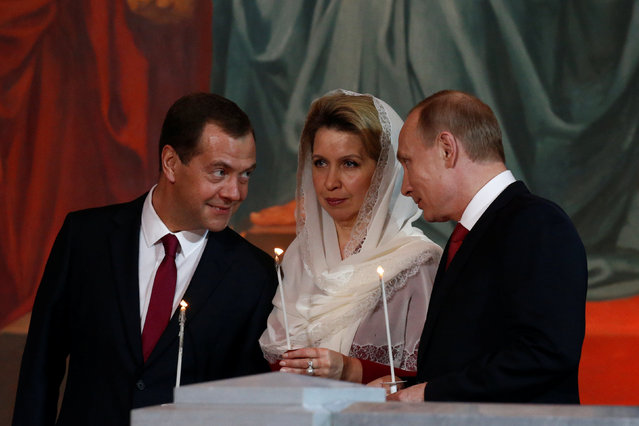 Russian President Vladimir Putin (R), Prime Minister Dmitry Medvedev and his wife Svetlana attend an Orthodox Easter service in the Christ the Saviour Cathedral in Moscow, Russia, May 1, 2016. (Photo by Sergei Karpukhin/Reuters)