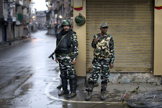 Indian paramilitary soldiers stand guard during security lockdown in Srinagar, Indian controlled Kashmir, Wednesday, August 14, 2019. India has maintained an unprecedented security lockdown to try to stave off a violent reaction to Kashmir's downgraded status. Protests and clashes have occurred daily, thought the curfew and communications blackout have meant the reaction is largely subdued. (Photo by Dar Yasin/AP Photo)