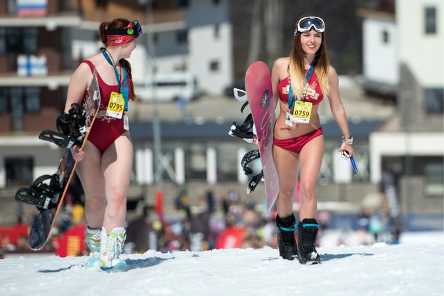 Girls dressed in swimsuits participate in the BoogelWoogel alpine carnival at the Rosa Khutor Alpine Resort in Krasnaya Polyana, Sochi, Russia on April 1, 2017. (Photo by Artur Lebedev/TASS)