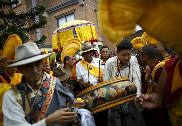 Tibetans dressed in traditional attire take part in a function organized to mark the 80th birthday celebrations of Dalai Lama in Kathmandu July 6, 2015. (Photo by Navesh Chitrakar/Reuters)