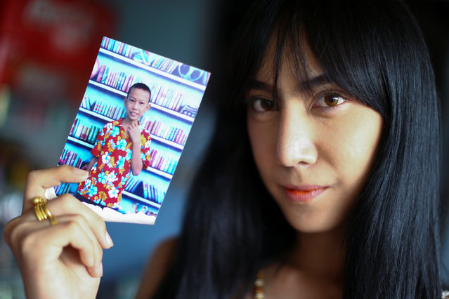 Kanphitcha Sungsuk holds up a picture of herself as a young boy after an army draft at her home near Klong Toey, the dockside slum area in Bangkok, Thailand, April 6, 2017. (Photo by Athit Perawongmetha/Reuters)