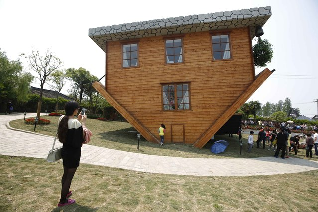 Tourists visit at an upside-down house at Fengjing Ancient Town, Jinshan District, south of Shanghai, May 1, 2014. (Photo by Aly Song/Reuters)