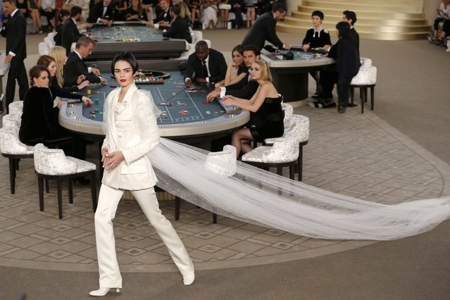 U.S. model Kendall Jenner presents a creation by German designer Karl Lagerfeld as part of his Haute Couture Fall Winter 2015/2016 fashion show for French fashion house Chanel at the Grand Palais which is transformed into a casino in Paris, France, July 7, 2015. (Photo by Stephane Mahe/Reuters)