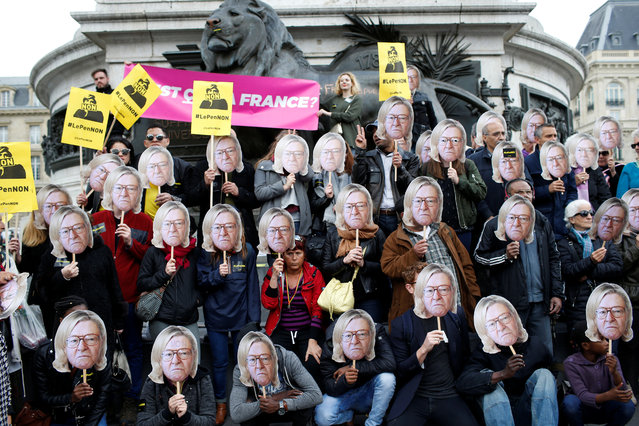 Activists wear masks depicting the face of Jean-Marie Le Pen, the founder of the French far-right National Front, with the hair of his daughter Marine Le Pen, French National Front (FN) candidate for 2017 presidential election, during a demonstration as part of traditional May Day labour day march in Paris, France on May 1, 2017. (Photo by Gonzalo Fuentes/Reuters)