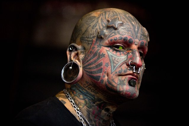 Victor Peralta poses for a picture during the 10th annual Buenos Aires Tattoo Show in Buenos Aires, Argentina, Friday, March 7, 2014. (Photo by Natacha Pisarenko/AP Photo)