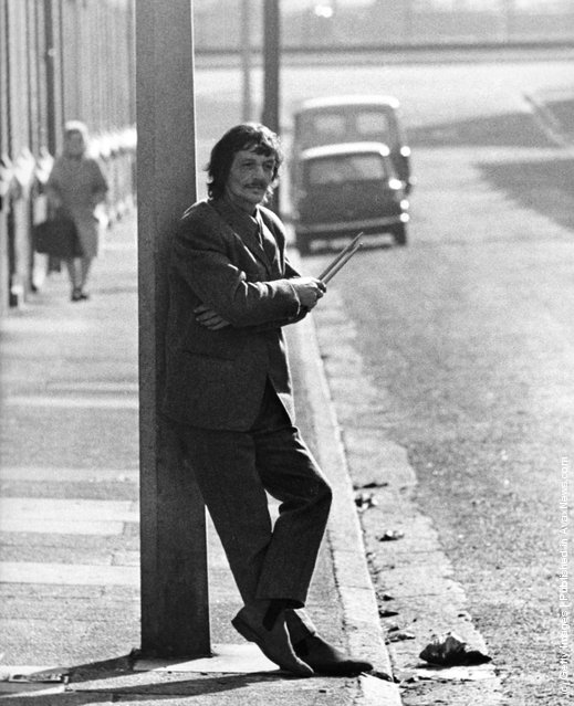 Tommy Moore, an early drummer for The Beatles, in a street near the River Mersey holding drumsticks on March 3, 1970