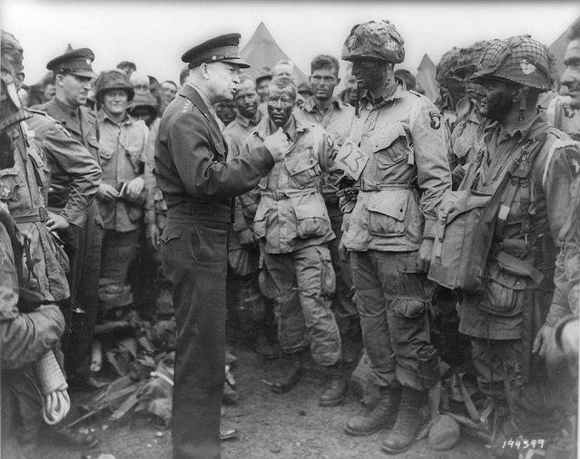 Allied forces Supreme Commander General Dwight D. Eisenhower speaks with U.S. Army paratroopers of Easy Company, 502nd Parachute Infantry Regiment (Strike) of the 101st Airborne Division, at Greenham Common Airfield in England, June 5, 1944. REUTERS/US National Archives