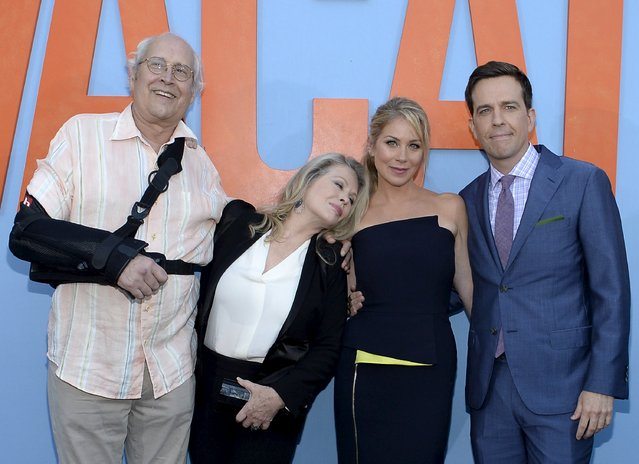 """Cast member Chevy Chase (L), Beverly D'Angelo, Christina Applegate and Ed Helms (R) pose during during the premiere of the film """"Vacation"""" at the Regency Village Theatre in the Westwood section of Los Angeles, California July 27, 2015. (Photo by Kevork Djansezian/Reuters)"""
