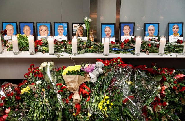 Flowers and candles are placed in front of the portraits of the flight crew members of the Ukraine International Airlines Boeing 737-800 plane that crashed in Iran, at a memorial at the Boryspil International airport outside Kiev, Ukraine on January 8, 2020. (Photo by Valentyn Ogirenko/Reuters)