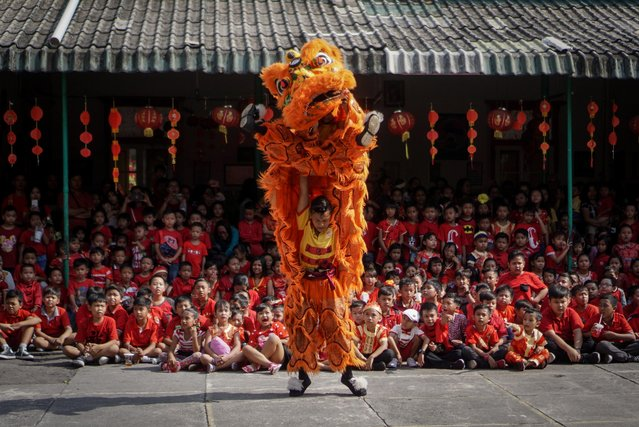 People perform a traditional Chinese lion dance to introduce Chinese culture ahead of Chinese Lunar New Year Celebration in Solo, Central Java, Indonesia, January 21, 2020. (Photo by Mohammad Ayudha/Antara Foto via Reuters)