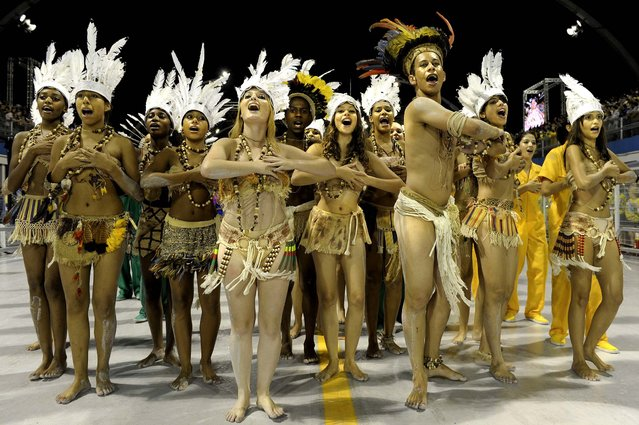 Revellers of the Unidos do Peruche samba school sing and dance at the Sambadrome in Sao Paulo, Brazil