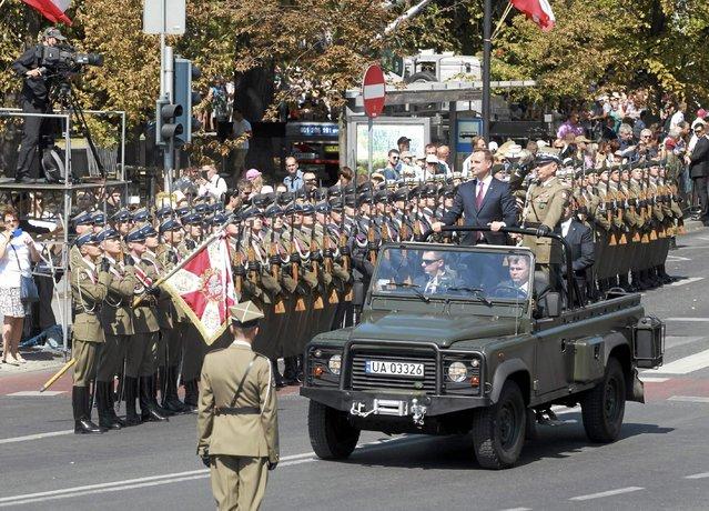 Polish President Andrzej Duda and Chief of Staff Gen. Mieczyslaw Gocul review troops prior to a military parade during Armed Forces Day in Warsaw, Poland August 15, 2015. (Photo by Przemyslaw Wierzchowski/Reuters/Agencja Gazeta)