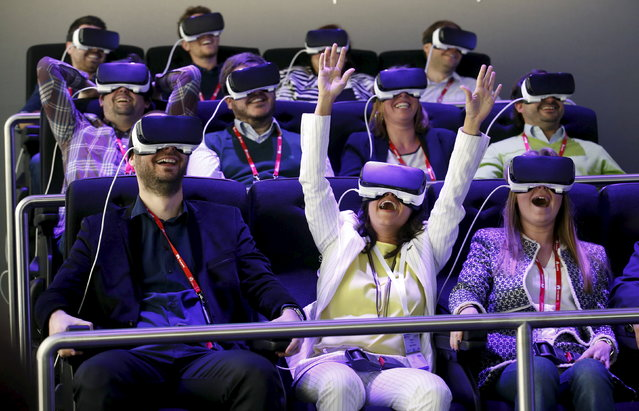 People test Samsung Gear VR glasses at their stand during the Mobile World Congress in Barcelona, Spain, February 23, 2016. (Photo by Albert Gea/Reuters)