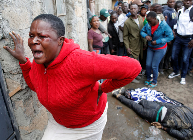 A woman cries after a supporter of opposition leader Raila Odinga was killed by police, witnesses said, in Mathare slum in Nairobi, Kenya August 9, 2017. (Photo by Goran Tomasevic/Reuters)