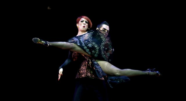 Nicolas Tobarez (R) and Rosalia Alvarez from Argentina, who are representing the city of Marcos Juarez, dance during the Stage style final round at the Tango World Championship in Buenos Aires, August 27, 2015. (Photo by Marcos Brindicci/Reuters)