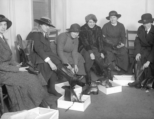 Women police appointed for duty at a munitions works trying on new boots. United Kingdom, 30th January 1917. (Photo by A. R. Coster/Topical Press Agency)
