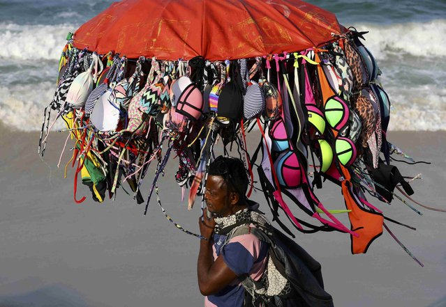 A vendor peddles bikinis along Copacabana Beach a day before the opening ceremony of the Rio 2016 Olympic Games in Rio de Janeiro, Brazil, August 4, 2016. (Photo by Paul Hanna/Reuters)
