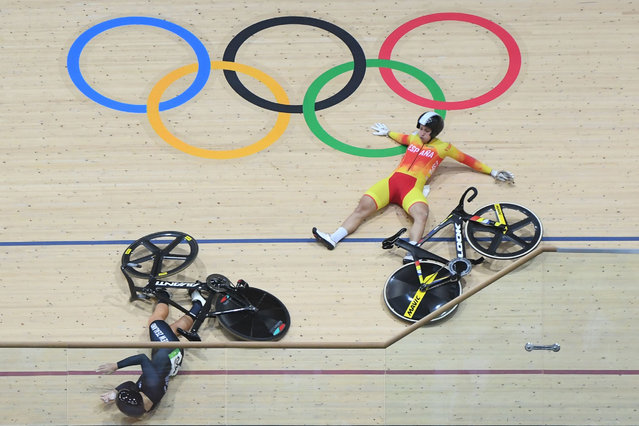 New Zealand's Olivia Podmore (L) and Spain's Tania Calvo Barbero fall during the women's Keirin first round track cycling event at the Velodrome during the Rio 2016 Olympic Games in Rio de Janeiro on August 13, 2016. (Photo by Greg Baker/AFP Photo)